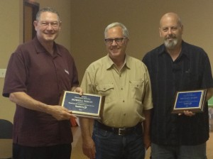 TradeNet sales representatives Nowell WIsch, left, and Mike Rubin, right, were recognized by TradeNet owner Tom Mertz for their years of excellent service to the company.